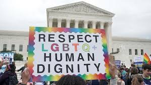 Sign in front of the Supreme Court that says Respect LGBTQ Human Dignity